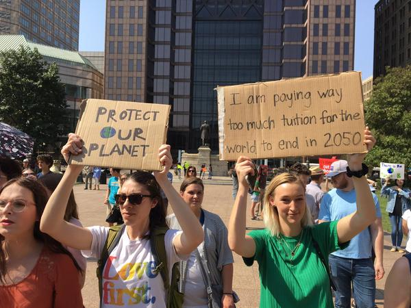 Many of the signs at the climate change rally at the Statehouse were handmade.