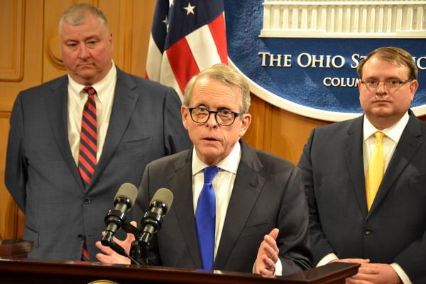Speaker Larry Householder (R-Glenford), Gov. Mike DeWine, Senate President Larry Obhof (R-Medina) speak at a news conference in April 2019.