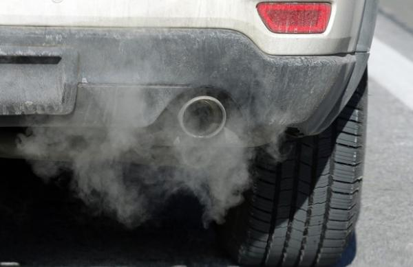 <p>Exhaust comes from the tailpipe of a vehicle Thursday, Jan. 3, 2019.</p>