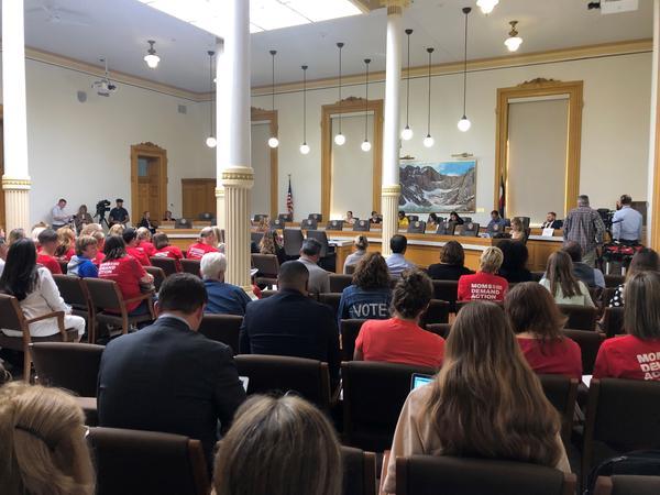 The school safety commitee hearing packed the old state library at the state Capitol on Friday.
