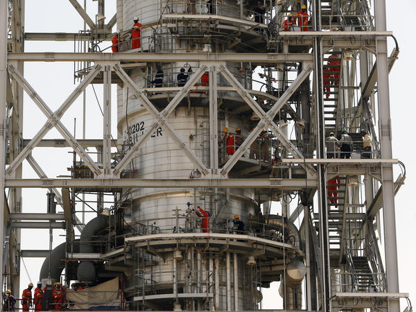 Workers fix damage at Saudi Aramco's Khurais oil field in Saudi Arabia on Friday after it was hit during a Sept. 14 attack.