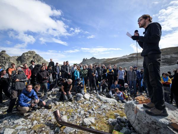 """People take part in a ceremony to mark the """"death"""" of the Pizol glacier on Sunday in eastern Switzerland."""