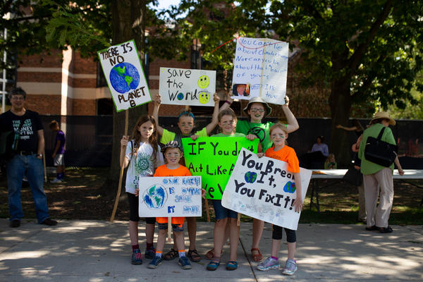 A group of elementary school children hold signs at the Washtenaw County protest.