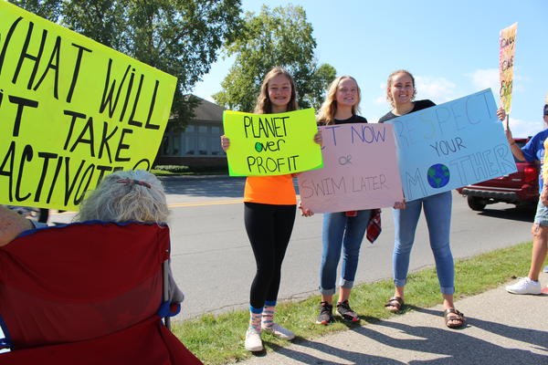 Three young activists in Traverse City who participated in a climate strike Friday.