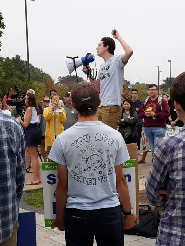 Students gathered on Northern Michigan University's campus to ask the university to commit to supporting a price on carbon.