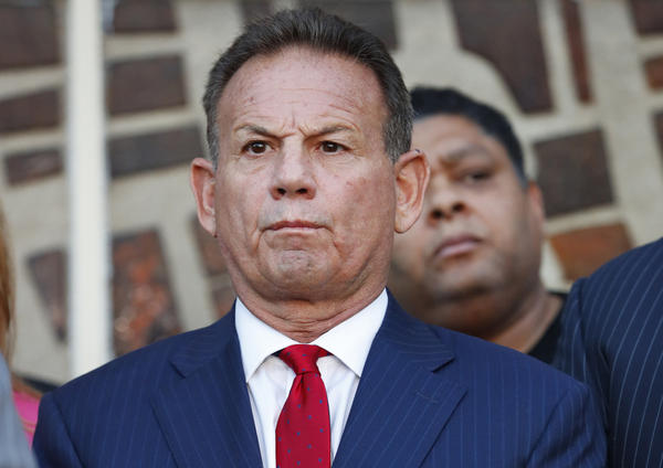Scott Israel listens to comments by his attorney at a news conference in January 2019. Florida Gov. Ron DeSantis suspended Israel over his handling of last year's massacre at Marjory Stoneman Douglas High School. Florida Senate special master Dudley Goodlette is recommending that Israel be reinstated.