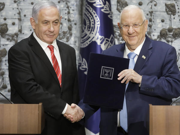 Israeli President Reuven Rivlin (right) shakes hands with Israeli Prime Minister Benjamin Netanyahu in Jerusalem. Netanyahu has been given the task of forming a new government.