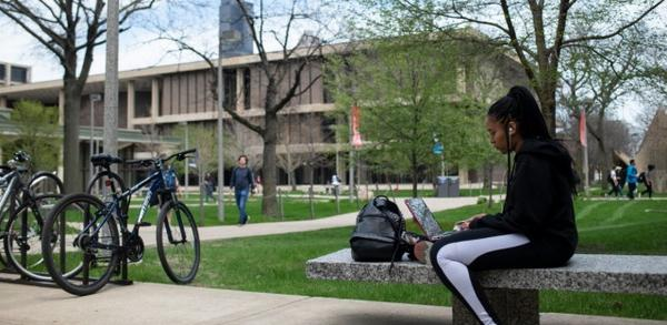 Senior Angelique Moore enjoys a spring day on the University of Illinois Chicago campus. Bucking a trend at Illinois universities statewide, UIC is seeing record enrollment.