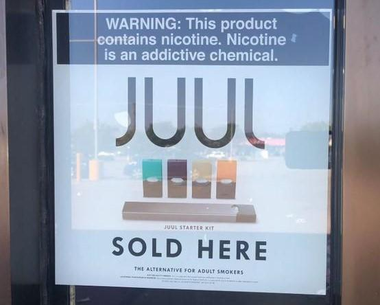 A local store advertising Juul vaping products.