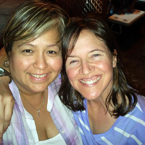 Tammy Boudreaux (right) with her partner, Laura Perez. Boudreaux is weighing the cost and benefits of purchasing health insurance.