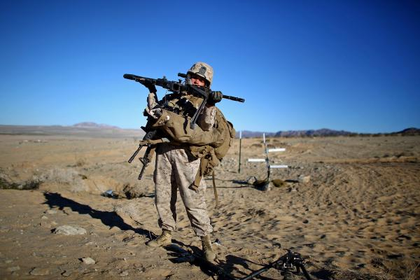 Letty Jamie carries all of the weapons for her team during a rescue simulation on the range during a live-fire exercise. Marines routinely carry packs and equipment weighing between 50 and more than 100 pounds.
