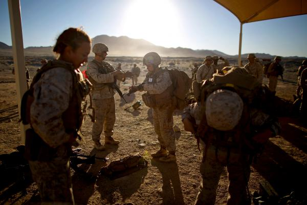 <p>Both male and female Marines ready to go on the range during a live-fire exercise. Marine officials estimate that about one third of the women in the infantry company (or Alpha Company) have dropped out, most due to injuries, though precise numbers have not been provided. </p><p></p>