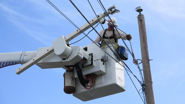 """Eric Elder, an Army reservist who came to Puerto Rico in early October to do power line work, says the work is challenging. """"Every pole is different, every pole has to be looked at and dressed differently."""""""
