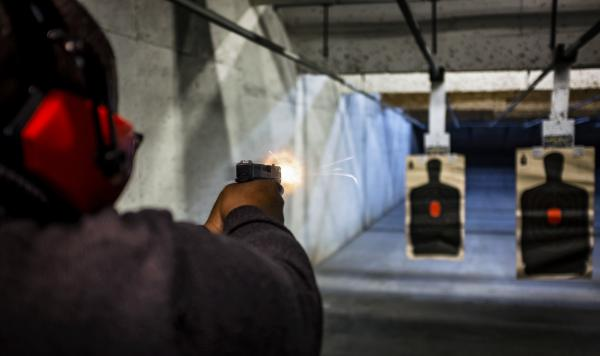 Stephen Yorkman of the Prince George's County chapter of the National African American Gun Association fires a 9mm handgun at the Maryland Small Arms Range in Upper Marlboro, Md., in March 2017.