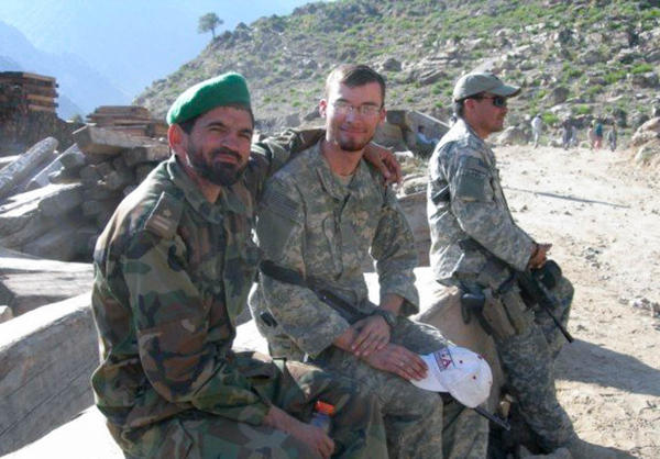 Davis, center, during his deployment to Afghanistan, where he served for nearly a year and a half as a human intelligence collector.