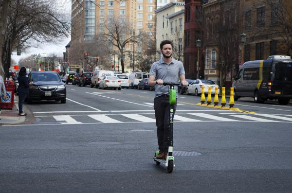 Matthew Lachance rides an electric scooter in Washington, D.C. Scooters have grown in popularity, and now ride-related injuries are a common sight at the George Washington University Hospital, according to Dr. Kate Douglass.