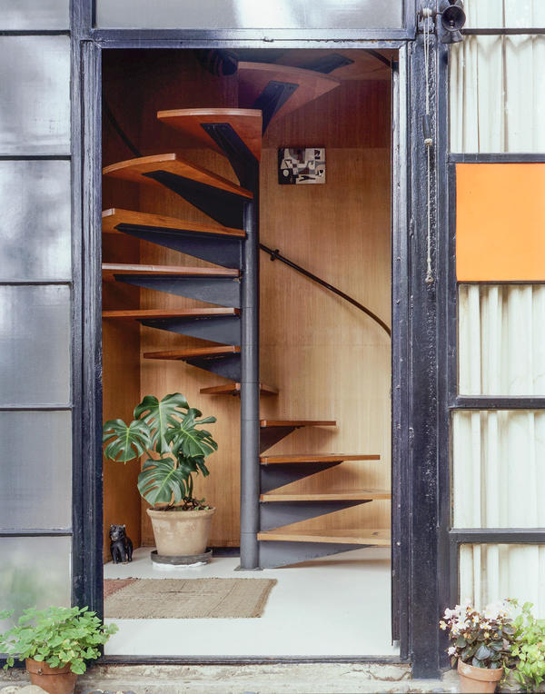 A spiral staircase leads to bedrooms on the second floor.