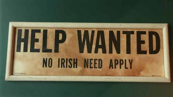 "A now-closed Irish pub in Lawrence, Mass., displayed an old ""Help Wanted/No Irish Need Apply"" — a common sight across the country in the mid-1800s."