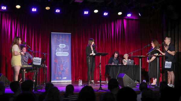 Contestants and comedian Bowen Yang compete in <em>Ask Me Another's</em> final round at the Bell House in Brooklyn, New York.