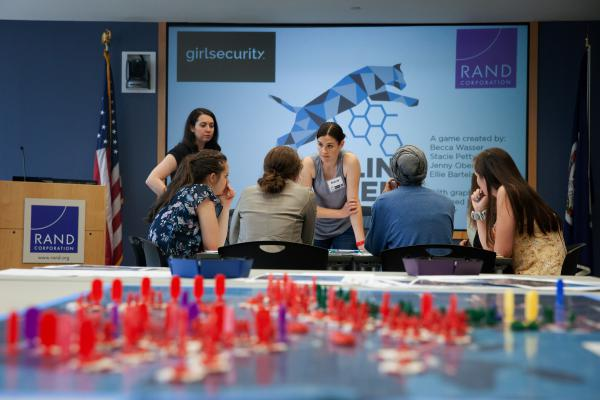 A unique gaming exercise allows girls to be generals for a day as part of an effort to boost women's participation in national security. Here, Stacie Pettyjohn, a political scientist and war-game designer at the RAND Corporation, talks to players about strategy.