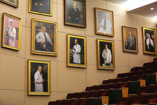 All the portraits hanging on the wall inside the Louis Bornstein Family Amphitheater at Brigham and Women's Hospital in Boston on June 12, 2018 were of men, nearly all white. The portraits have since been removed.