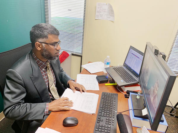 Dr. Abdul Subhan, a psychiatrist, at Meridian Health Services in Indiana, connects with patients over the Internet.