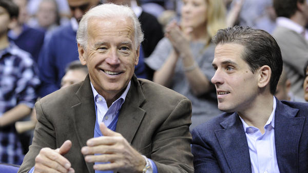 Then-Vice President Joe Biden and his son Hunter Biden attend a basketball game in Washington in 2010. Joe Biden frequently dealt with the Ukrainian government and pressed the government to deal with corruption issues. At the same time, Hunter Biden was on the board of a leading gas company in Ukraine. President Trump and some of his supporters have called for an investigation.