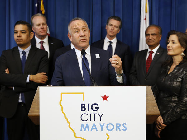 Sacramento Mayor Darrell Steinberg (center), head of Big City Mayors, discusses the homeless problem after the group met with California Gov. Gavin Newsom in March. Steinberg says it's time for any adversarial relationship between cities and the Trump administration to end.