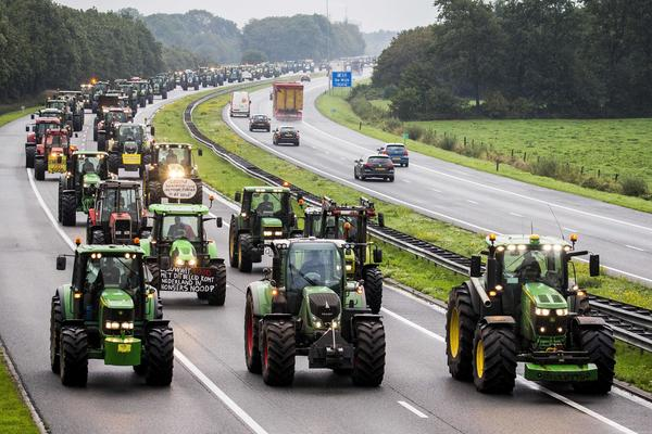 In the Netherlands, farmers block a major highway with their tractors on Tuesday during a national protest. Farmers say their livestock and operations are being unfairly blamed for greenhouse gas emissions.