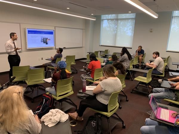 Professor Frank Orlando teaches a course on the presidency, and Tuesday's class focused on impeachment. KERRY SHERIDAN/WUSF PUBLIC MEDIA
