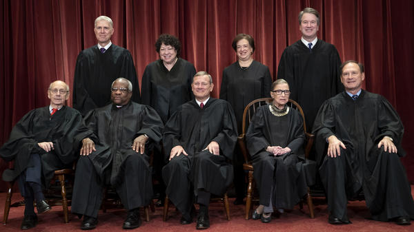 The Supreme Court justices, pictured in November 2018, start a new term on Monday.