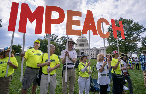 Activists rally for the impeachment of President Donald Trump at the Capitol in Washington, Thursday, Sept. 26, 2019.