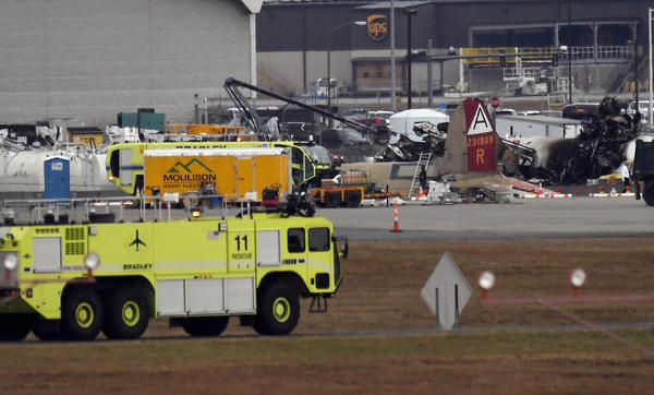 Emergency crews respond to where a World War II-era bomber B-17 plane crashed at Bradley International Airport in Windsor Locks, Conn., Wednesday, Oct. 2, 2019.