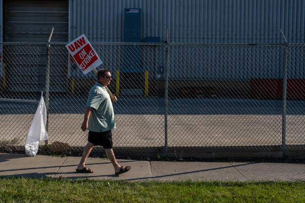 A striking member of United Auto Workers Local 1005 walks in front of the General Motors Metal Fabrication Division in Parma, Ohio Tuesday, Sep. 17, 2019.