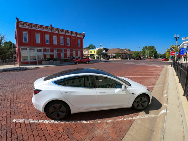 The City of Lindsborg's new Tesla Model 3 parked in front of City Hall.