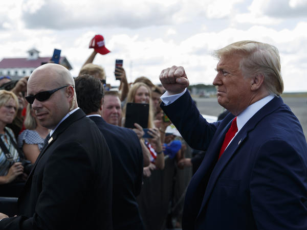 President Trump greets supporters after arriving at Florida's Ocala International Airport on Thursday to give a speech on health care at The Villages retirement community. In his speech, Trump gave seniors a pep talk about what he wants to do for Medicare, contrasting it with plans of his Democratic rivals.