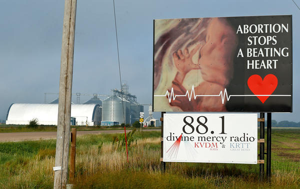 A roadside sign in rual Kansas opposing abortion.