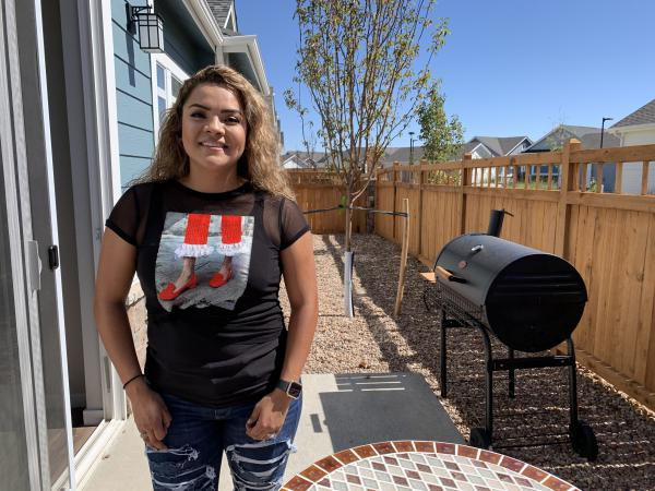 Itzel Alarcon recently moved into a rental development near Denver. She says she's renting for now because she saw relatives hurt by the housing crash and is worried that home values might drop again.