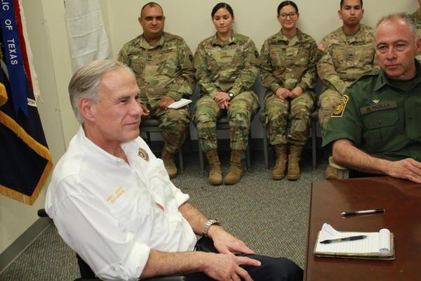 Gov. Greg Abbott briefs National Guard troops in Weslaco in April 2018.