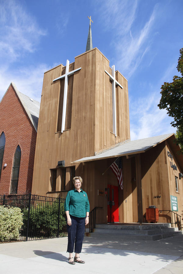 Briana LeClaire is the director of Women and Children's Ministries for the Boise Rescue Mission. Here, she stands in front of City Light Home For Women And Children, a homeless shelter that offers voluntary faith-based programs.