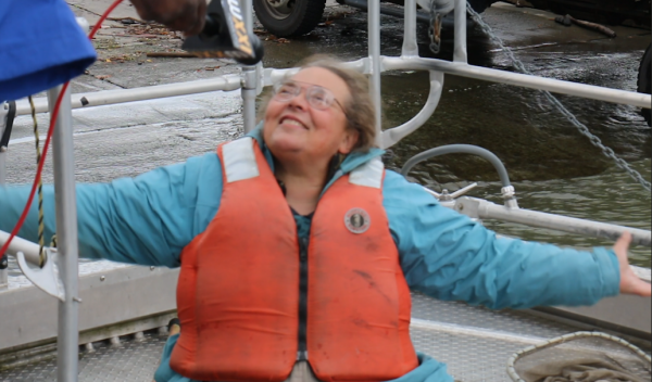 Dawn Dittman, lead scientist of the US Geological Survey on a boat to restock sturgeon.
