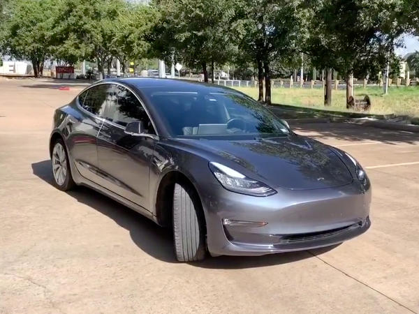A Tesla 3 model is remotely driven with the company's phone app in Austin, Texas, in this still image taken from social media video.