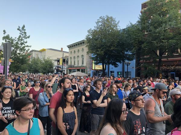 Thousands fill Fifth St. in the quater-mile stretch of business and entertainment venues of the Oregon District for a vigil honoring the victims of the August mass shooting.