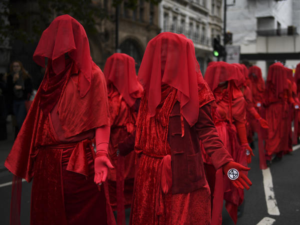 Climate activists take part in a demonstration Monday in London, where police say they've arrested dozens of protesters as the Extinction Rebellion group attempts to draw attention to climate change.