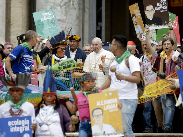 Pope Francis walks in procession on the occasion of the Amazon synod at the Vatican on Monday. The pope opened a three-week meeting as he fended off attacks from conservatives who are opposed to his ecological agenda.