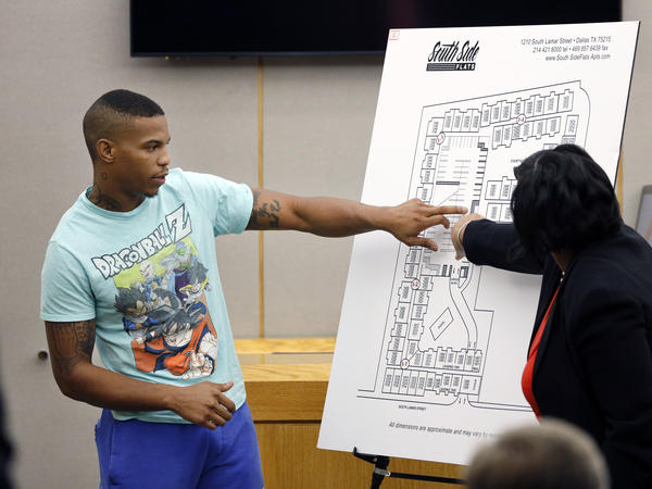 Joshua Brown answers questions from prosecutors while pointing to a map of the South Side Flats apartment complex during the murder trial of former Dallas police officer Amber Guyger. Ten days after his testimony, Brown was found shot to death.