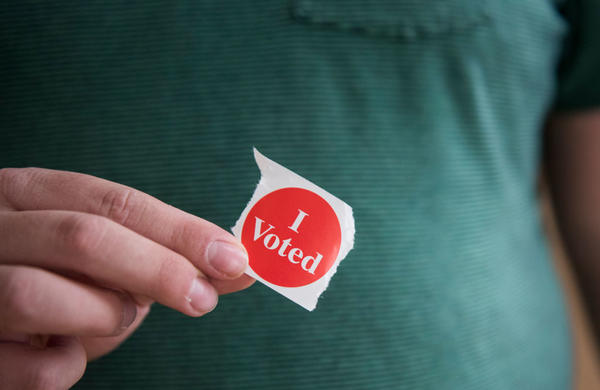 """A voter in Minnesota holds their """"I Voted"""" sticker. (Stephen Maturen/Getty Images)"""