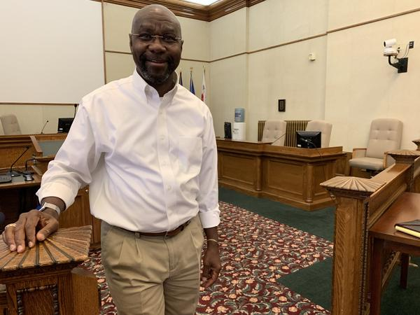 Wilmot Collins stands in the Helena City Commission chambers before a meeting. He moved to Montana in the early 1990s and is now running for the U.S. Senate.