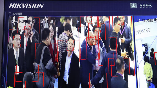 Visitors are tracked by face recognition technology from state-owned surveillance equipment manufacturer Hikvision at the Security China 2018 expo in Beijing. Hikvision is one of several firms that have been added to a U.S. trade blacklist.
