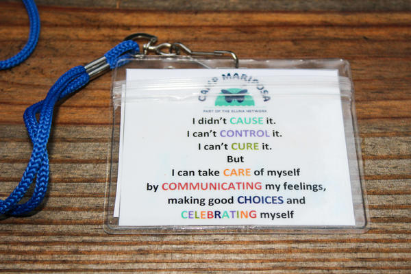 "The lyrics of the Camp Mariposa song, ""7 Cs,"" are printed out on lanyards so new campers can sing along. ""It helps me realize that I didn't cause what happened to me,"" one child said. ""It makes me feel much better."""